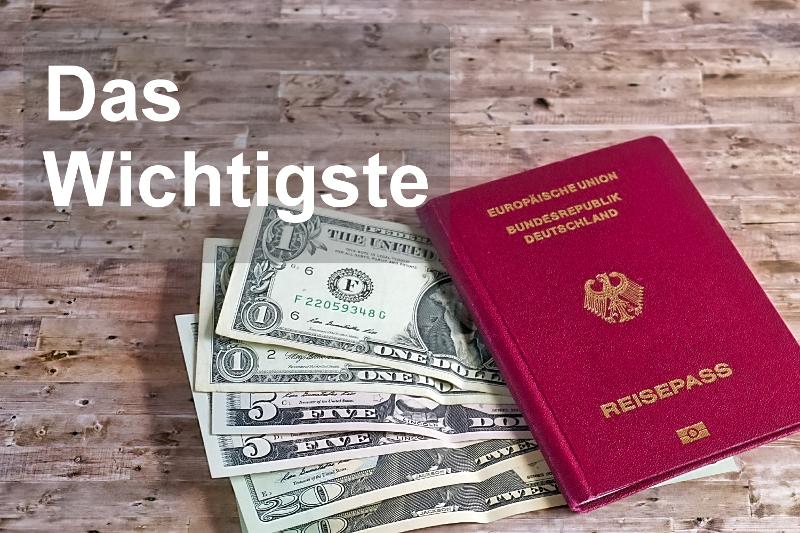Die wichtigsten Dinge für einen Reisenden sind abgebildet. Ein Reisepass und ein Bündel Dollarscheine.